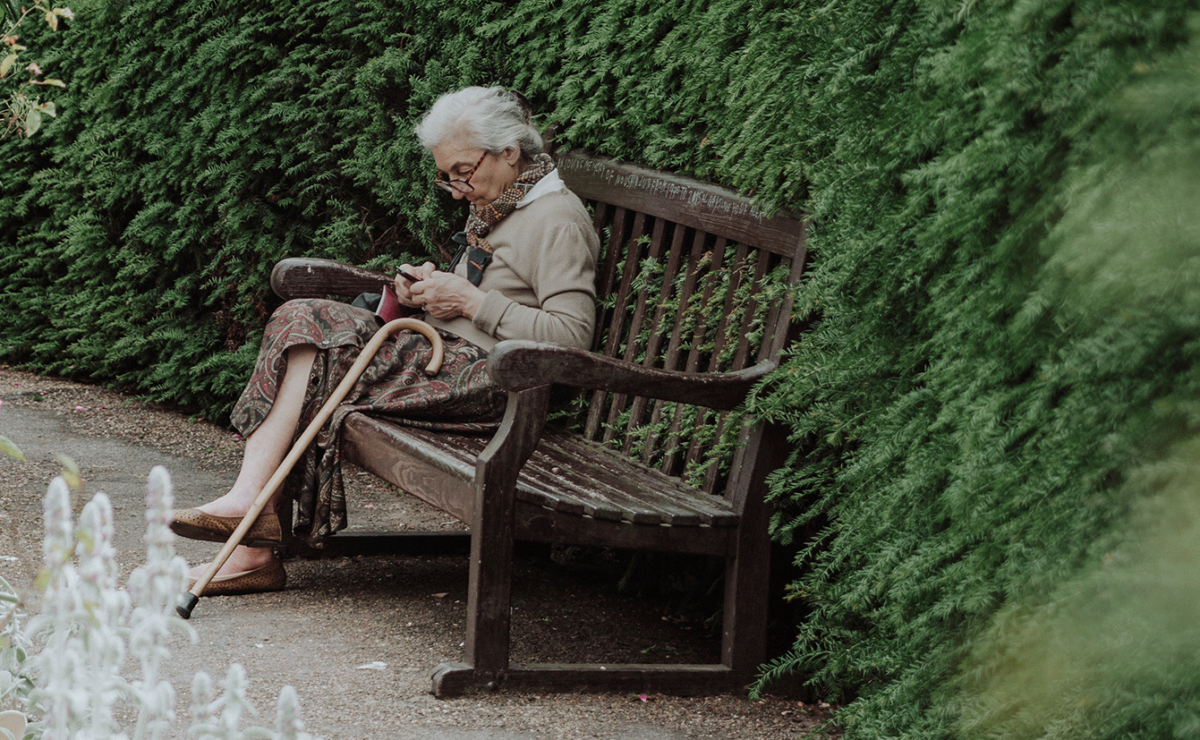 Older woman sitting on a bench
